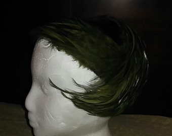 Vintage green feather hat.