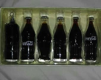 Coca cola evolution of the coca cola mini's