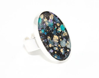 Splatter Painted Adjustable Ring - Acrylic in Silver Oval Ring - Black Galaxy Colorway: Black, Purple, Teal, Gold