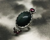 Máni new moon ink blue sheen obsidian, wine red garnet and sterling silver tassle ring