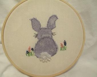 Grey bunny in flowers