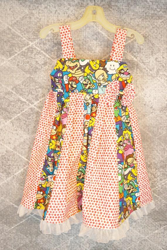 custom boutique dress made with nintendo mario fabric size 2-6