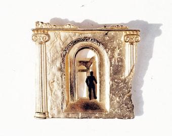 Man In Ruin Pin. 1988 Roman Novelty Brooch.