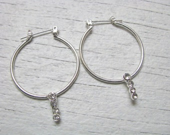 Pretty silver tone hoop earrings with faux rhinestone accents