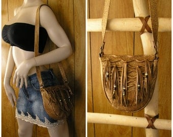 "Leather purse, honey lambskin with sculpted leather, beaded fringe with brown and cream trade beads, 21"" x 1"" flat strap, inside pocket"