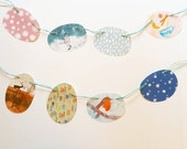 winter paper garland with illustrations