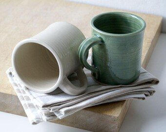Two funnel shaped mugs - hand thrown stoneware glazed in simply clay and forest green