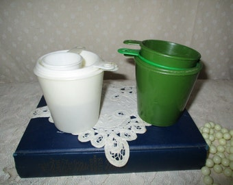 Plastic measuring Cups Cream and green
