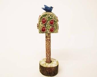 Pottery bird in an Apple Tree Ceramic sculpture