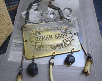 The Strange Case of the Necrophiliac Doctor. Antique coffin tag, Coyote bones & Skulls Gothic Necklace
