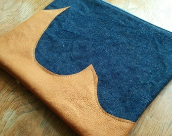 Denim clutch with two pieces of reclaimed brown leather for embellishment  - brown cotton lining with blue circles