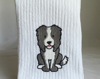 Border Collie on white vertical bar towel