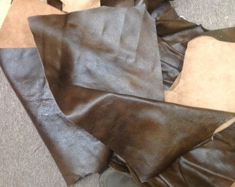 CLFE65.  Two Tome Brown Package of  4 Leather Cowhide Remnants