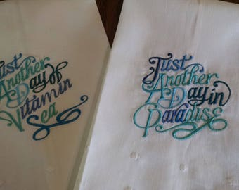 Pair of Just Another Day In Paradise Embroidery on White Tea Towels