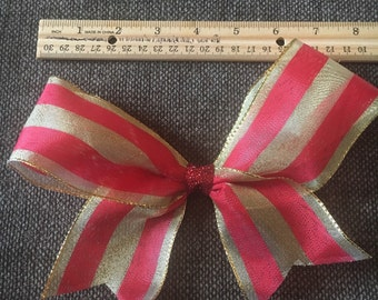 Handcrafted red and gold bow