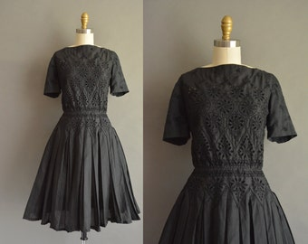 Carlye 50s black cotton eyelet vintage dress with a pleated full skirt. vintage 1950s dress