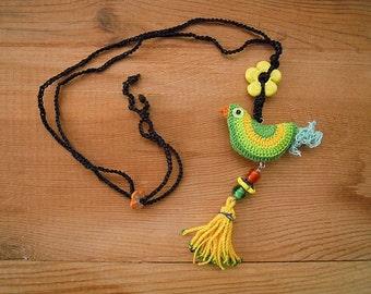 crochet bird necklace with tassel, green yellow cotton