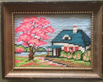 vintage framed needlepoint, house with a pink tree in bloom,  landscape, finished, framed, 6 by 8 1/2 inches