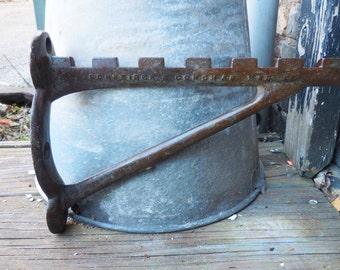 Antique cast iron Hook Rack farm barn salvage Tool Notched hanger hardware