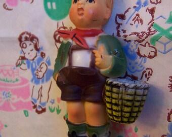 little boy with basket figurine