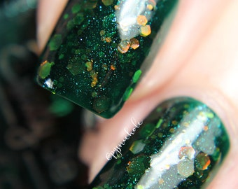 "Nail polish - ""Blackmail Milestone"" red to green shifting glitter in a dark green jelly base"