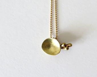 abstracted organic form dainty pendant