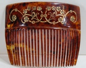 Antique 1890's tortoise shell womans hair comb decorated with faux diamonds. Guaranteed old. Great color.