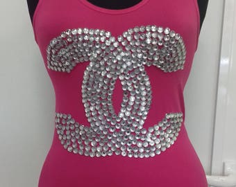 Pink top with crystals.