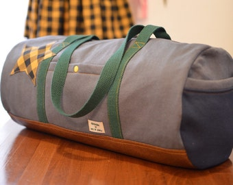 Duffle bag with a star patch