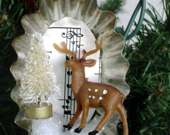 vintage oval tart tin Christmas ornament hymnal sheet music with plastic deer mini bottle brush tree snow