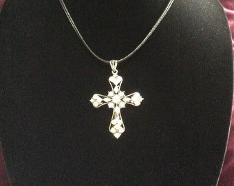 Rhinestone cross with leather chain and claw clasp