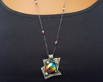 Dicroic glass cabochon pendant with fine silver setting