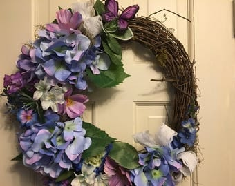 Blue hydrangea with purple accents, spanish moss and butterfly.