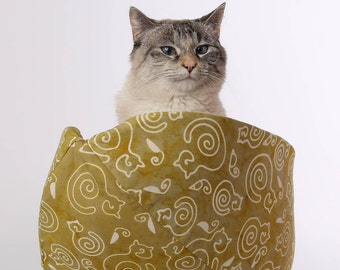 Modern style pet bed - the Cat Canoe, a nest style bed for kitties, made in batik fabric
