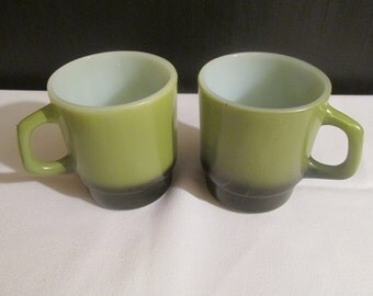 A Pair of Fire King Avacodo and Black Stackable Coffee Mugs. / Cups