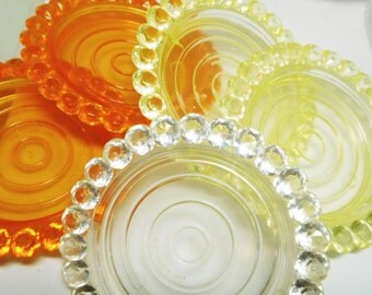 1960's 'Jeweled' Coasters Bright Orange Yellow Clear Plastic set of 5 Mod