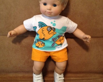 15 inch boy doll (modeled by Bitty Baby) Fish Shirt and gold shorts.