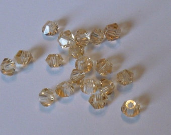 3 MM Light Topaz Bicone Glass Beads