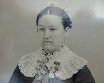 antique tintype - woman with lace collar sitting in chair