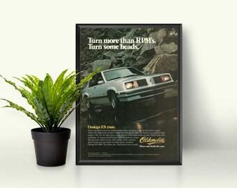 Oldsmobile Omega ES 2800 • Classic Oldsmobile • Garage Gift • Car Guy Gift • Framed Car Picture • GM Car • 80s Car Ad • Car Driving Picture