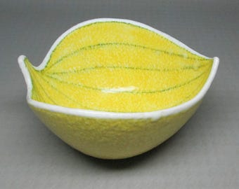 Yellow pottery bowl from Italy , shaped like a leaf