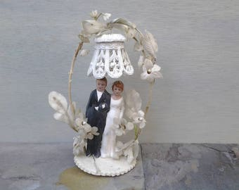 Vintage wedding cake topper - chalkware wedding figurine - bride groom - arch and bell - wedding decor - bridal shower - 50's wedding topper