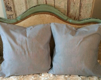 A pair of Farmhouse blue ticking fabric pillow covers. Ruffled envelope style