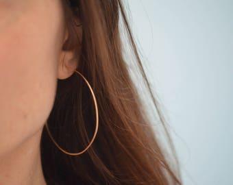 thin gold hoop earrings. large gold earrings. big gold hoop earrings. gold earrings. 14k gold filled hammered hoop earrings