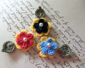 Small Crochet Flowers and Leafs Appliques. Set of Three Yellow Crochet Flowers and Leafs with Assorted Center.