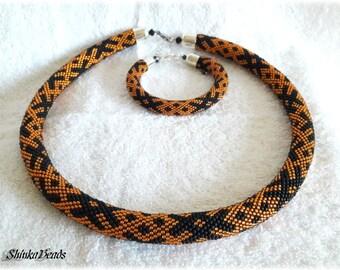 Ethnical ornament bead crochet necklace and bracelet black and orange handmade unique OZOLINS pattern