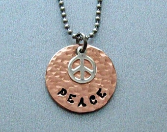 Peace symbol pendant necklace of hammered copper and a sterling silver peace sign charm on steel bead or silver box chain of your choice.