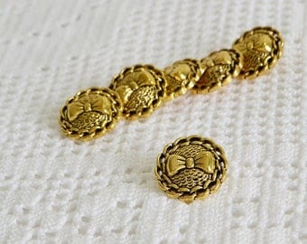 Gold buttons plastic , vintage supply, haberdasher exess , knitting and sewing supply