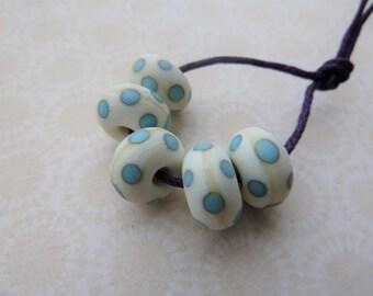 Handmade lampwork ivory and blue spot tumbled beads, UK set