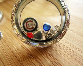 Go Cubs go!  Steel floating locket with Chicago Cubs charms- show your team spirit.  Stainless steel floating locket ring or necklace